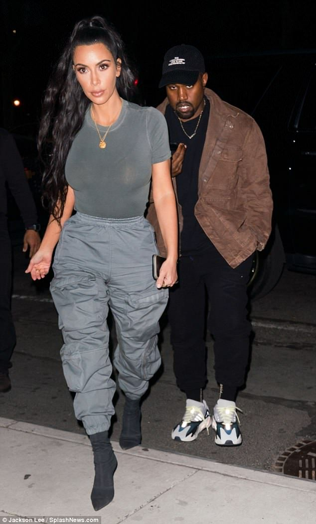 Kim Kardashian models semi-sheer top with Kanye West in NYC