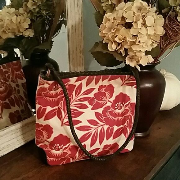 The Sak Floral Handbag The Sak Floral Handbag in Red and Cream Floral Print.  Red interior with faux wooden and leather accent and strap.  Faux leather bottom with just a bit of normal wear.  Other than that this fun handbag is in great condition! The Sak Bags Shoulder Bags