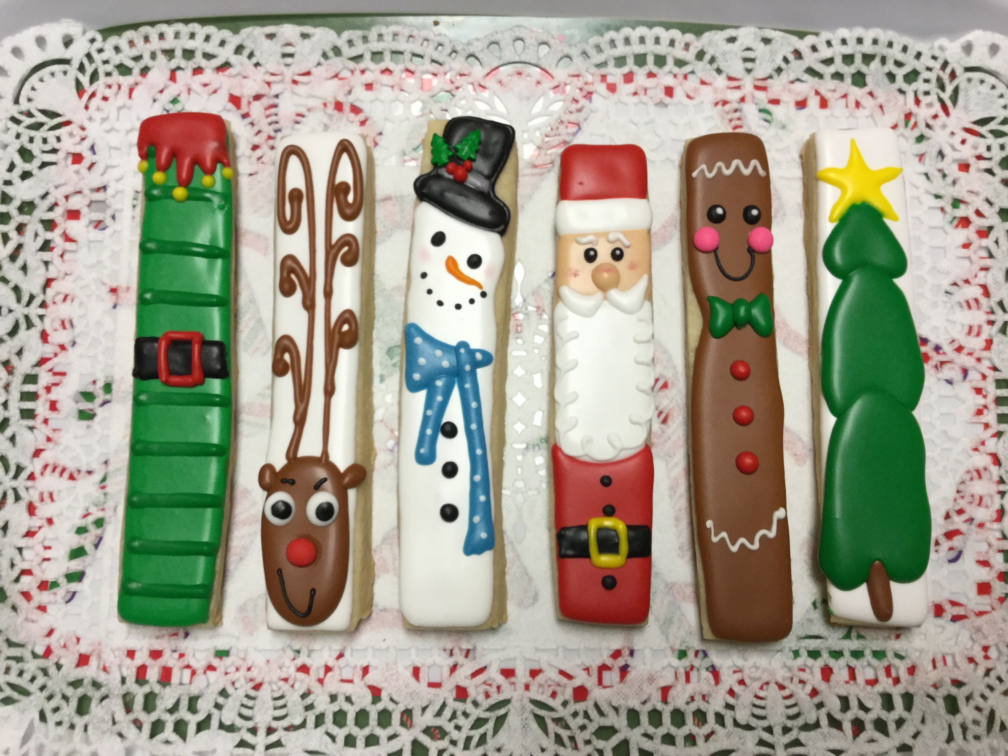 Decorated Stick Christmas Cookies by I Am the Cookie Lady