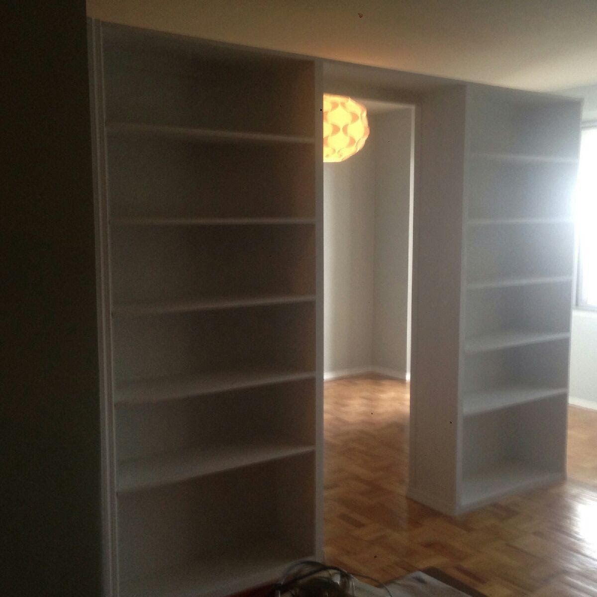 Door Partition custom bookcase partition with pocket door in nyc apartment. call