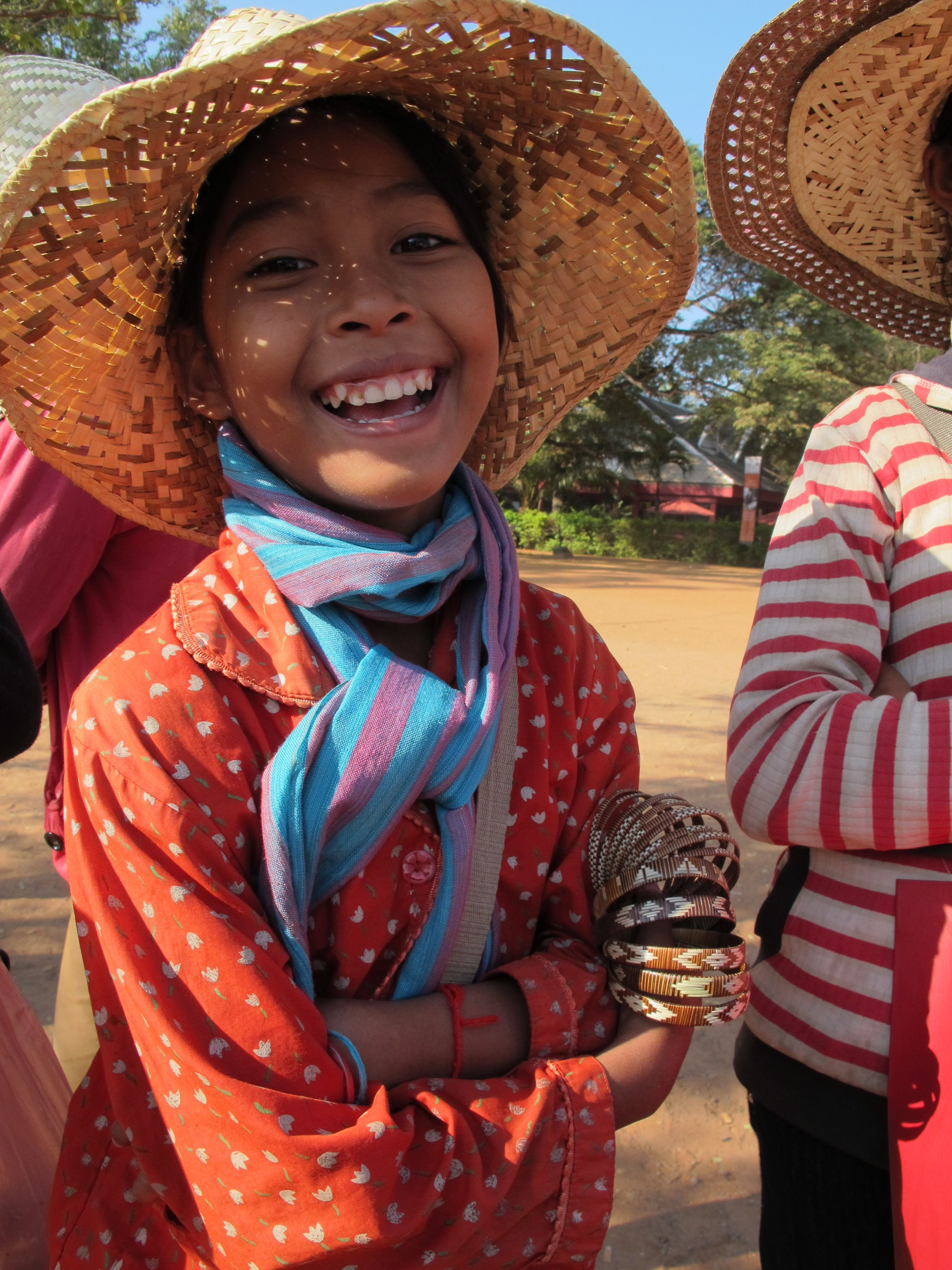 We bought these bracelets at Angkor Wat in Cambodia... how to resist a smile like that?  Pic by Anthea Paul