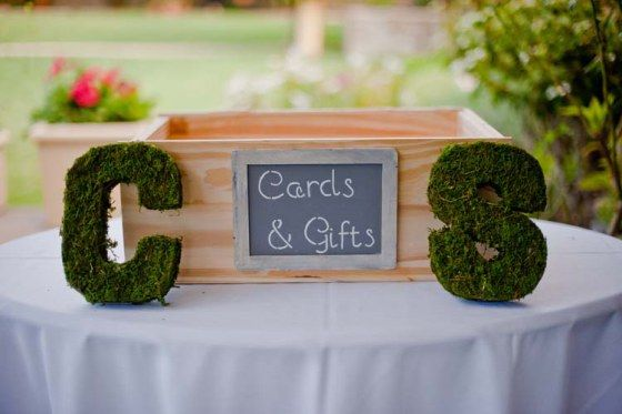 Create a cute box to hold cards and gifts brought to the wedding. Love the moss covered letters framing the box.