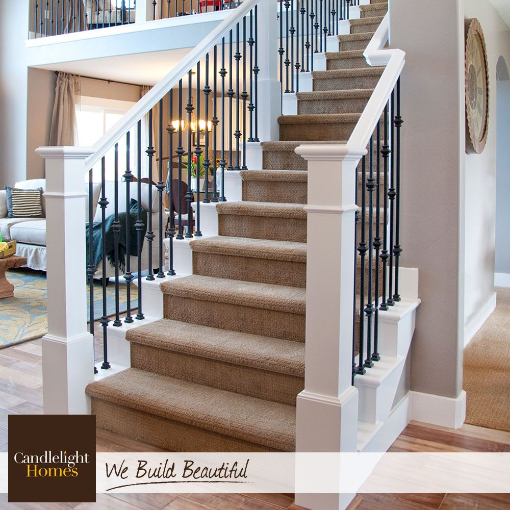 White Wood Railings And Wrought Iron Spindles Create The Perfect Contrast For Wrought Iron Stairs Wrought Iron Stair Railing Iron Stair Railing