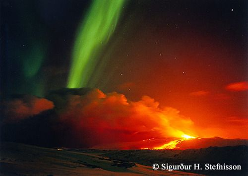 rwa42:    Volcano and Aurora in Iceland Image Credit & Copyright: Sigurdur H. Stefnisson   Explanation: Sometimes both heaven and Earth erupt. In Iceland in 1991, the volcano Hekla erupted at the same time that auroras were visible overhead. Hekla, one of the most famous volcanoes in the world, has erupted at least 20 times over the past millennium, sometimes causing great destruction. The last eruption occurred only twelve years ago but caused only minor damage. The green auroral band…