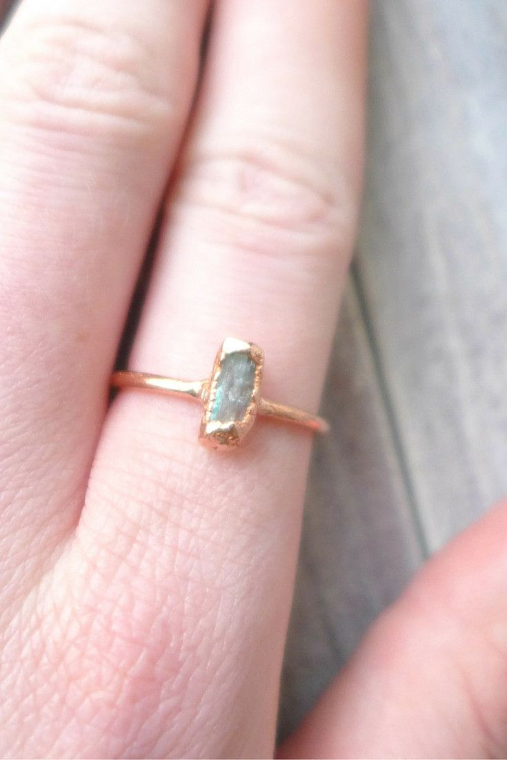 In this aquamarine stacking ring, a circle of pure copper embraces ...