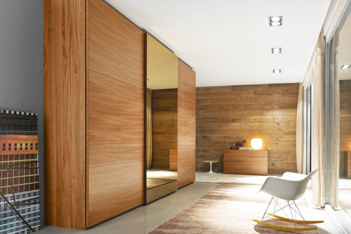 Luxury Bedroom With Brown Wood Sliding Closet Doors And Walk In Wooden Closet Mirror Sliding