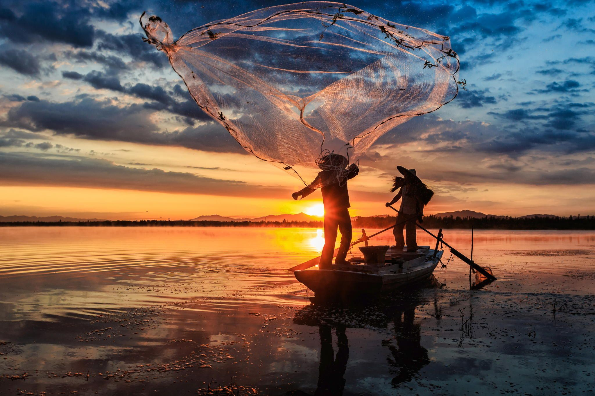 Photograph cast fishing net by bobby chen on 500px for Throw nets for fishing
