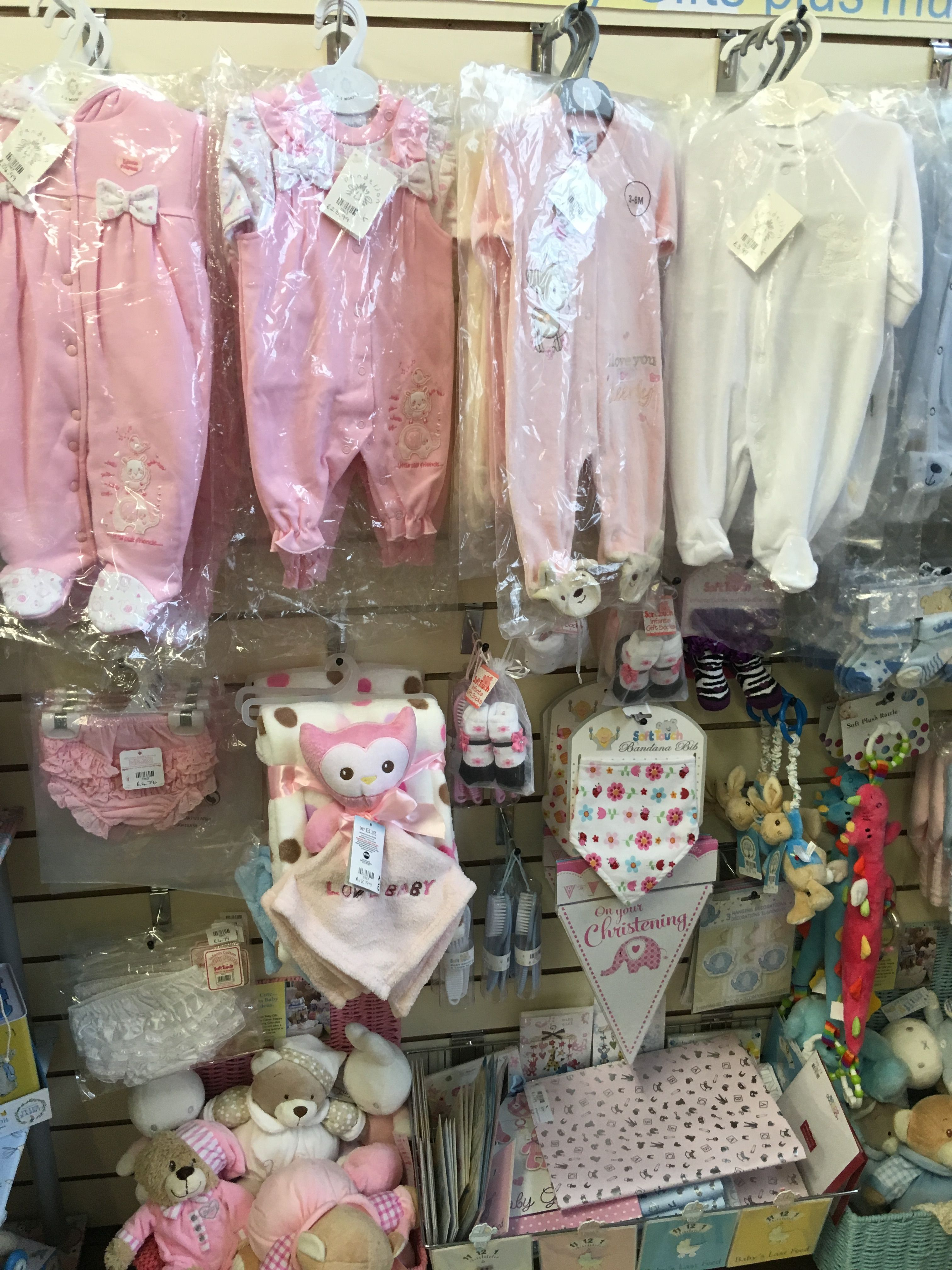 Shop Display - Babywear Display - Slatwall Panels - A simple yet eye catching baby clothes display. Complete with Slatwall chrome arms and Slatwall hooks. Slatwall boards available in wood finishes and a range of colours.