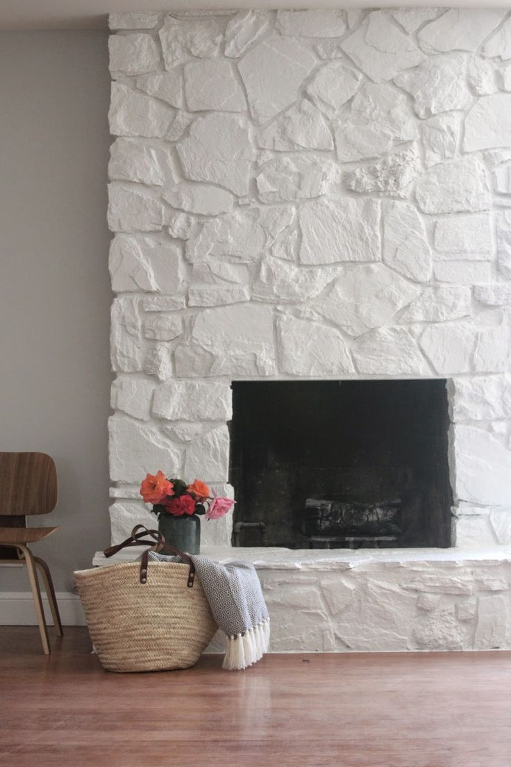 Just love this painted rock stacked stone masonry fireplace chimney