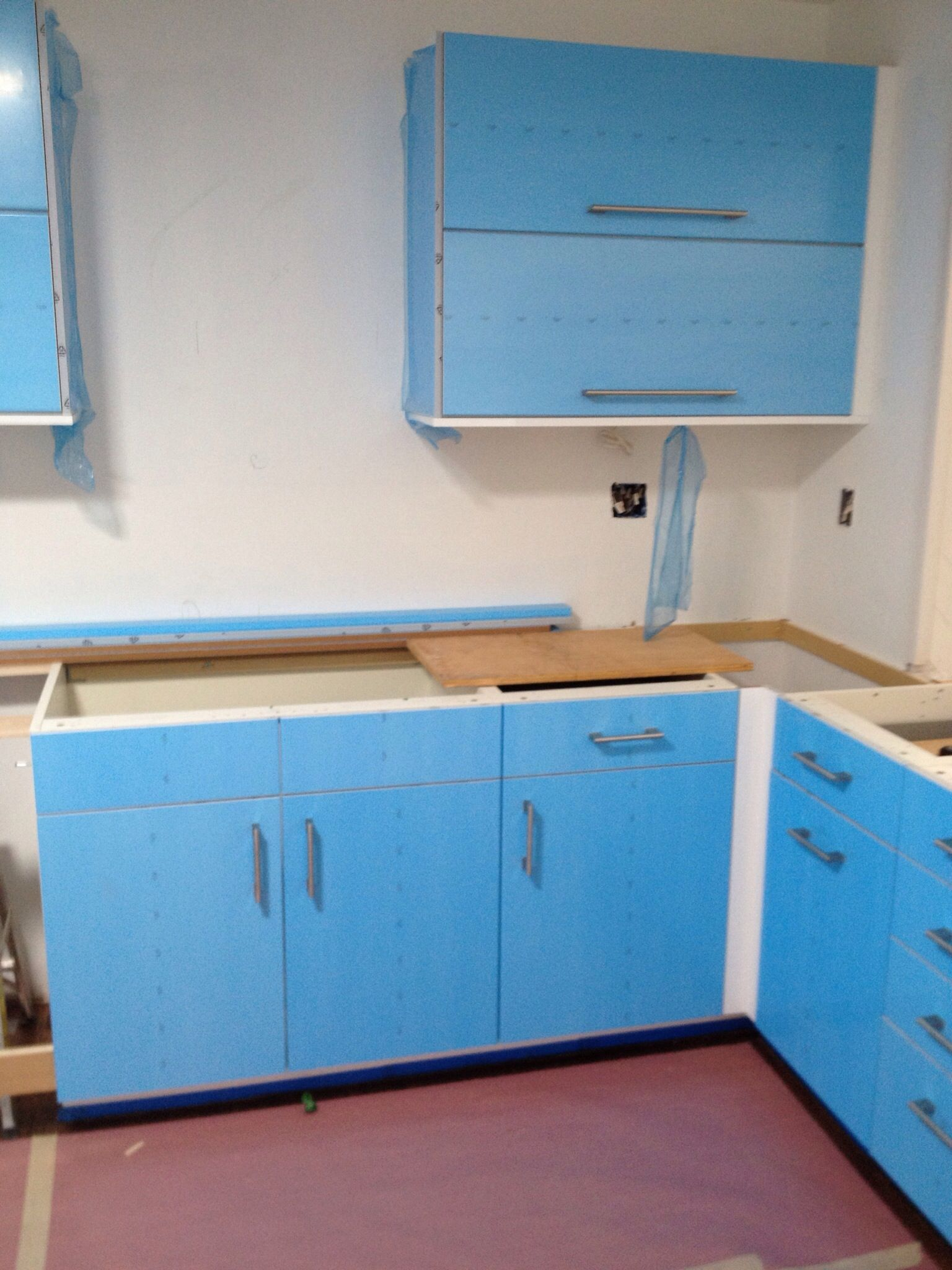 Handles on drawers and cabinets - portion of sink wall. With the ...