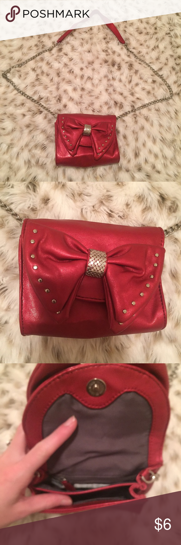 Nine West Mini Purse with bow Nine West red bow purse! Small. Has a chain to carry it! So cute! Hardly used! No flaws Nine West Bags Mini Bags