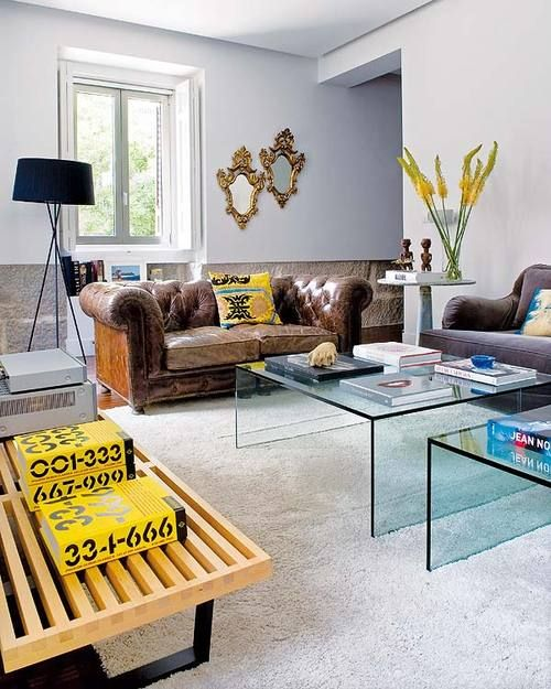 distressed leather couch super contemporary coffee tables victorian mirrors and african sculptures madrid apartmentapartment ideasapartment