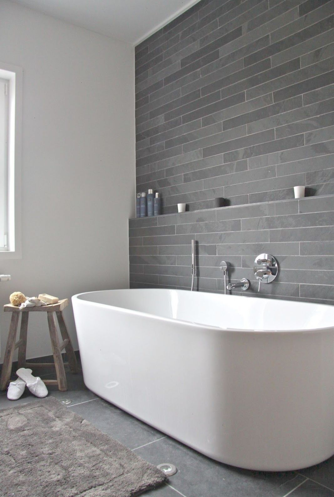 I Think Watching This Tub Fill With Water Would Be A Pleasure Unto Itself Bathroom White Vanity And Toiletblack Tile And Back Modern Bathroom Bathroom Renovations Beautiful Bathrooms