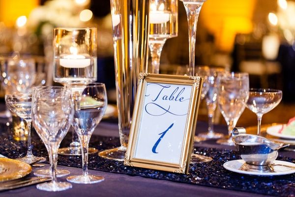 Gold Framed Table Number    Photography: Renee Sprink Photography   Read More:  http://www.insideweddings.com/weddings/a-blue-white-gold-military-wedding-at-duke-university-chapel/622/