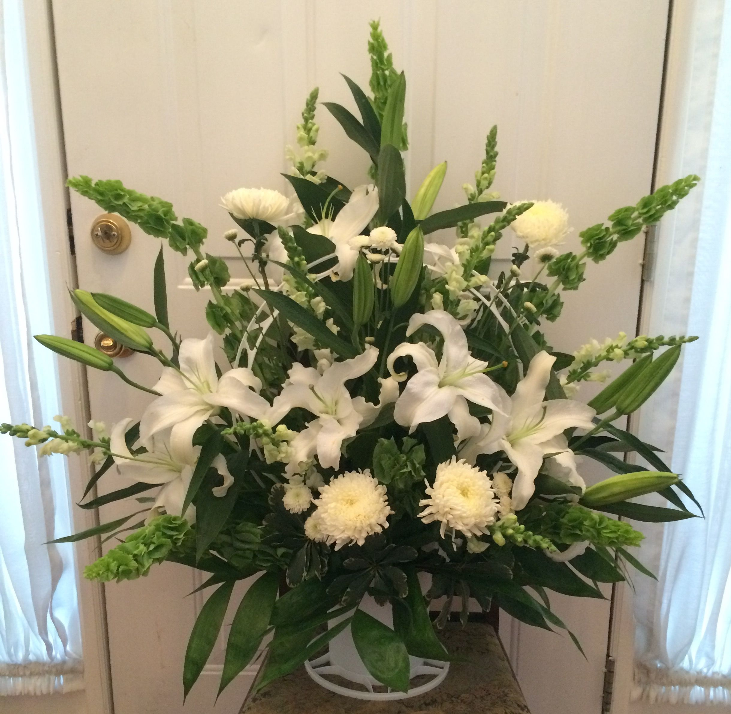 All White Funeral Basket With Bells Of Ireland Funeral Basket Funeral Tributes Fresh Flowers