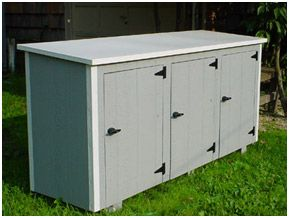 must have: garbage can enclosure up against garage  Only