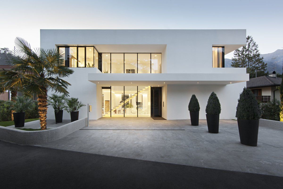 Front view modern white house design by monovolume architecture 18 white double storey houses