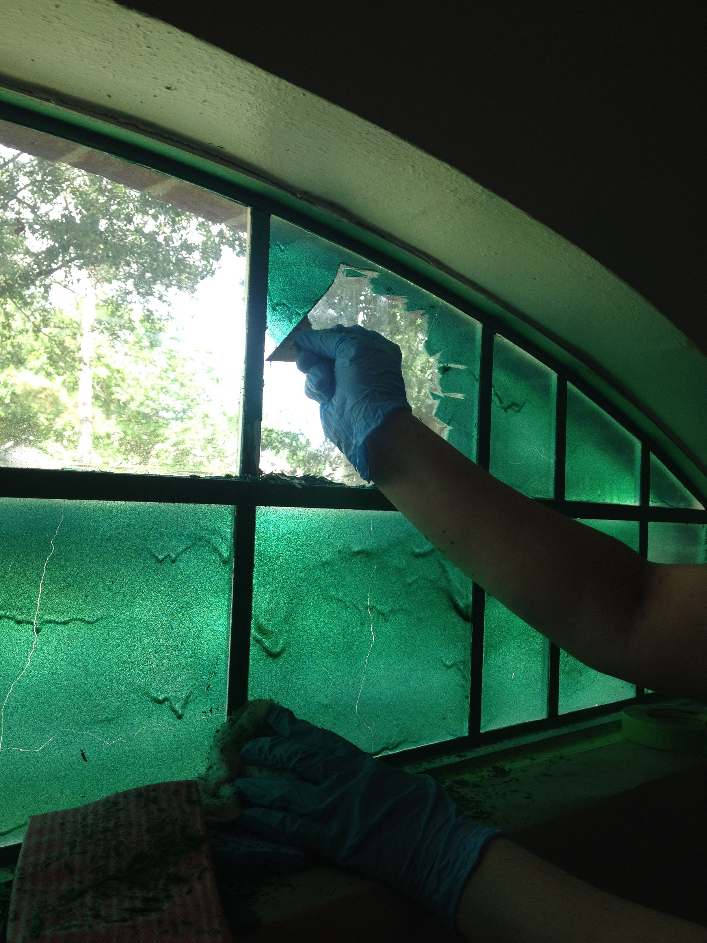 How to remove paint from a glass window spray googone found at home depot onto the glass window then gently scrape away paint with a razor blade
