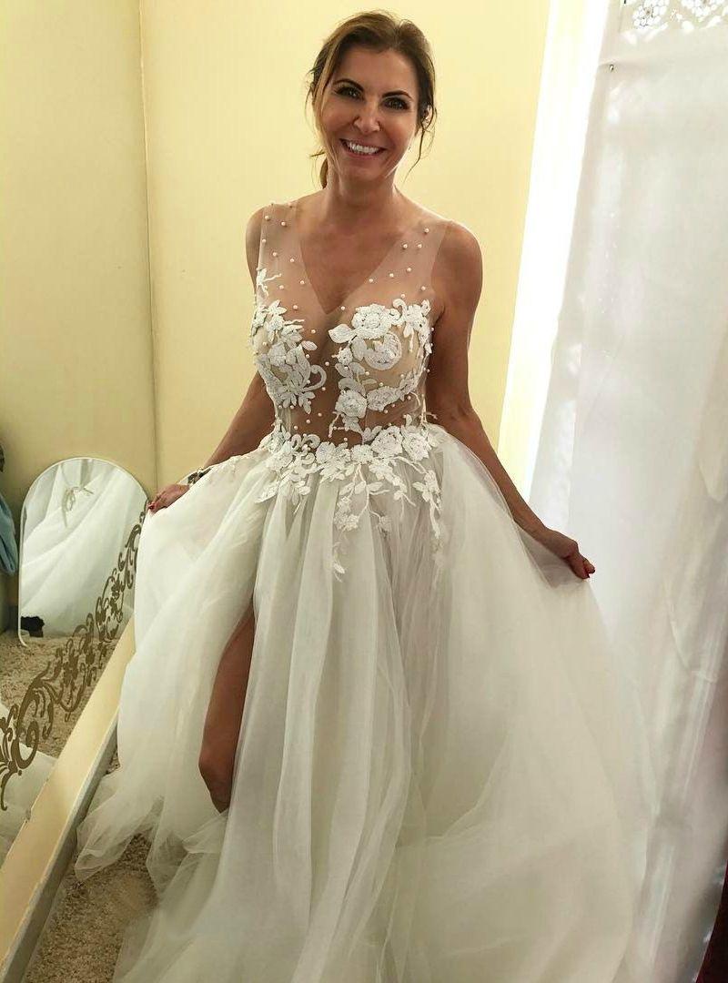 Sheer wedding dress  Sexy Sheer Corset Puffy Beach Wedding Dress with Slit and Long Train