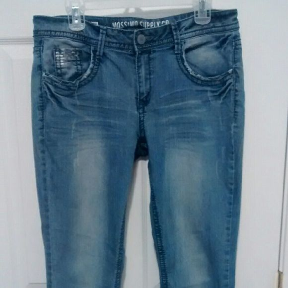 Woman's Boot Cut Light Denim Trendy Jeans These are pretty flattering. Size says 15. But they are tight fitting. So I'd say they fit like a smaller size.  Has silver sequins on back pockets n one in front. Looks cool. Cuz its subtle. Mossimo Supply Co Jeans Boot Cut