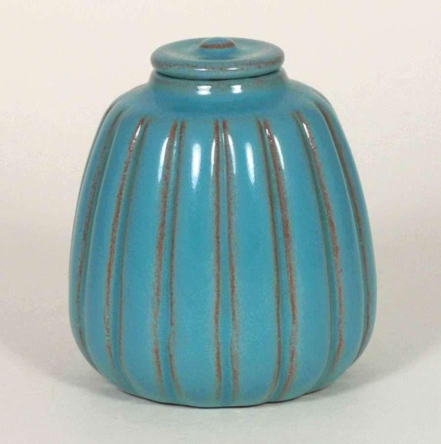 California Faience, ribbed lidded jar, bright Persian Blue glaze, ca. 1922-1933, 3 5/8″ high (CF Fig. 2.22). Chip on underside of lid.