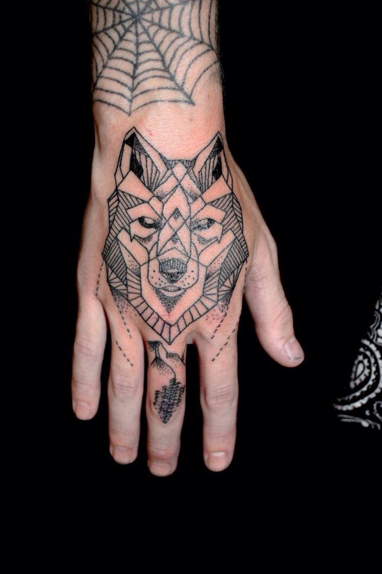 15cfeba8c Geometric wolf head hand tattoo. www.tattooguy.co.uk | Tattoos ...