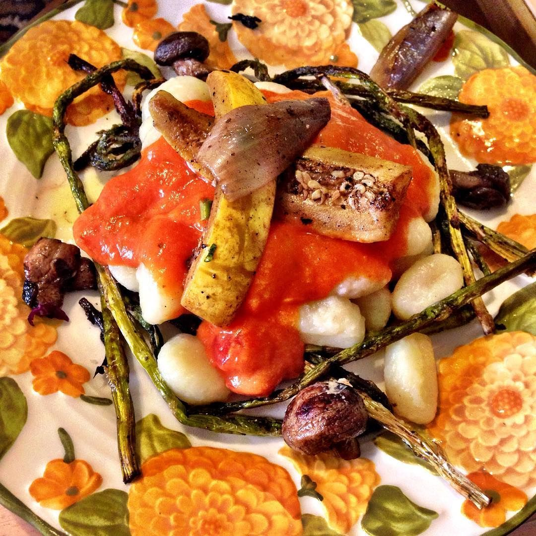 Gnocchi with a spicy pomodora sauce and assorted root veggies on a bed of roasted asparagus.  #MondayMotivation #SporkingClueless #OnePlateAtATime #MeatlessMonday