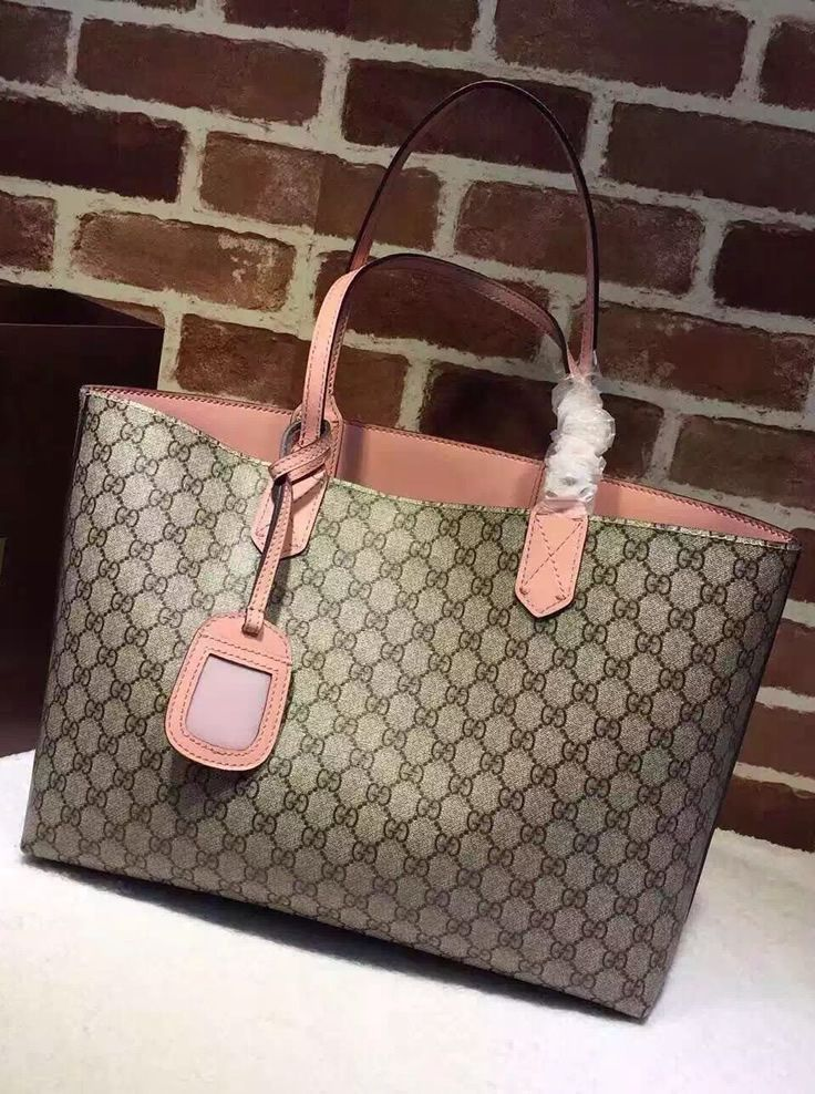 910c74cf532 Gucci Reversible beige ebony GG leather and pink leather tote. See more  Gucci collection at