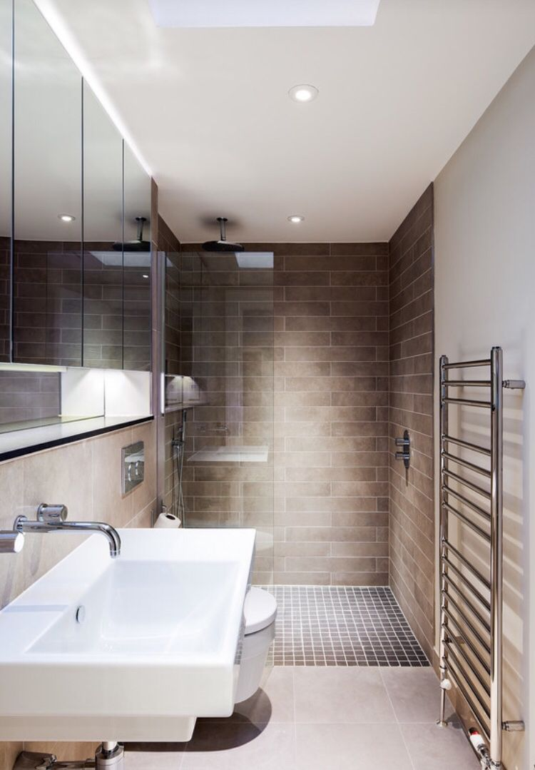 Beautifully simple modern bathroom with walk in shower ...