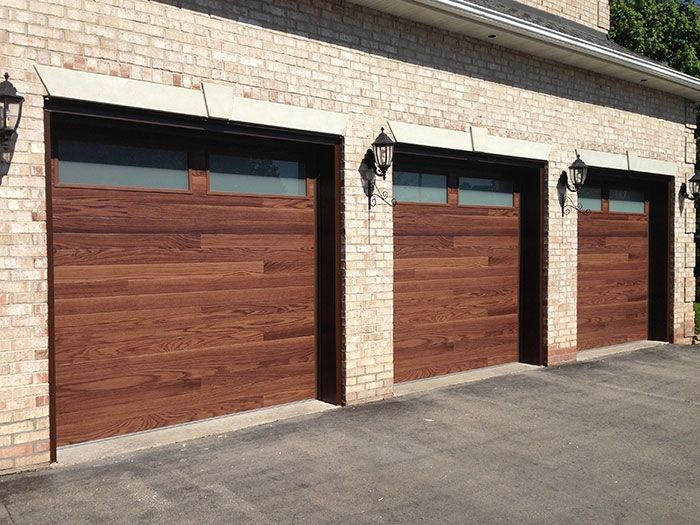 Modern Woodgrain Garage Doors With 2 Frosted Windows Installed By