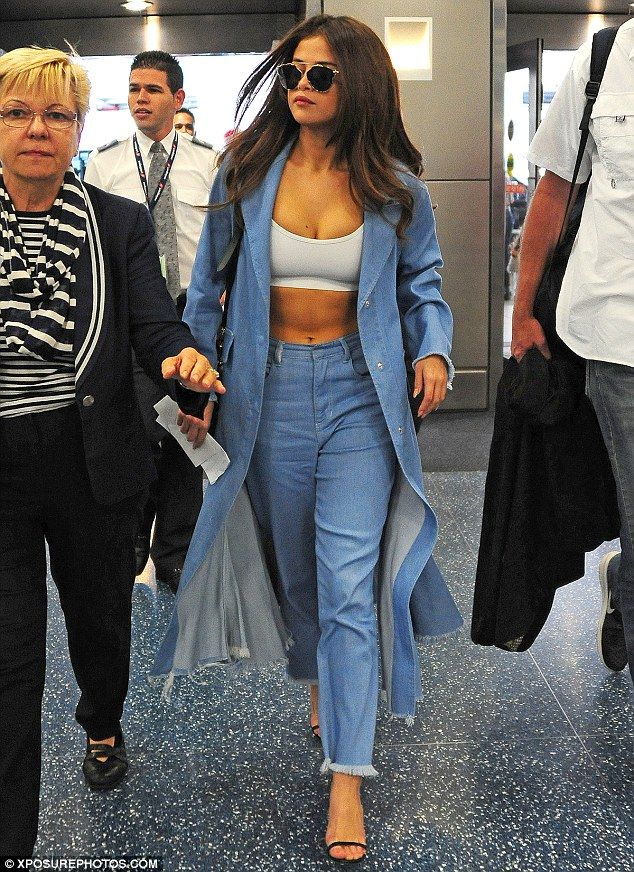 Fashion jean-ius! The Hands To Myself hitmaker strutted her stuff in a double denim ensemb...