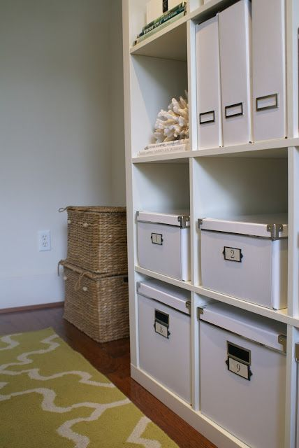 used expedit shelf and white boxes from ikea with ceramic tags home office organization