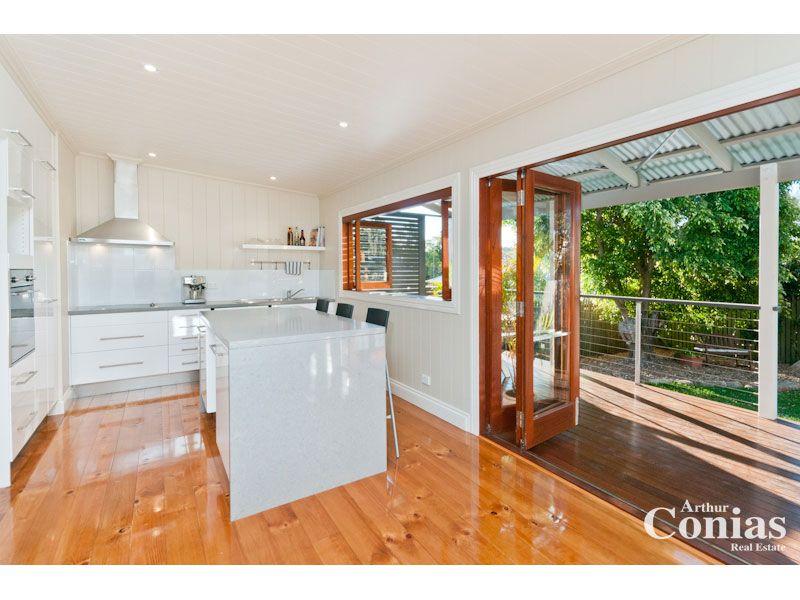 Kitchen servery next to accordion doors onto deck for Sliding glass doors onto deck