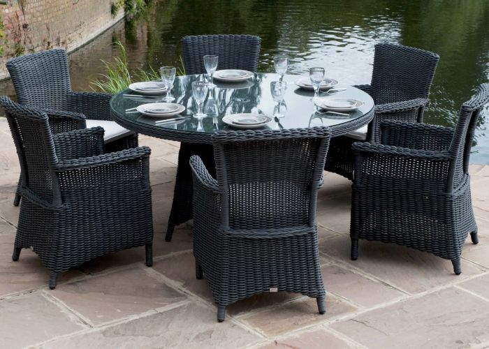 Black outdoors round dining table w six carver dining chairs