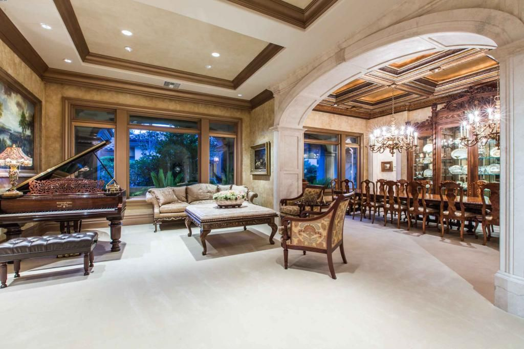 The expansive formal living room and dining room showcase beautifully finished ceilings