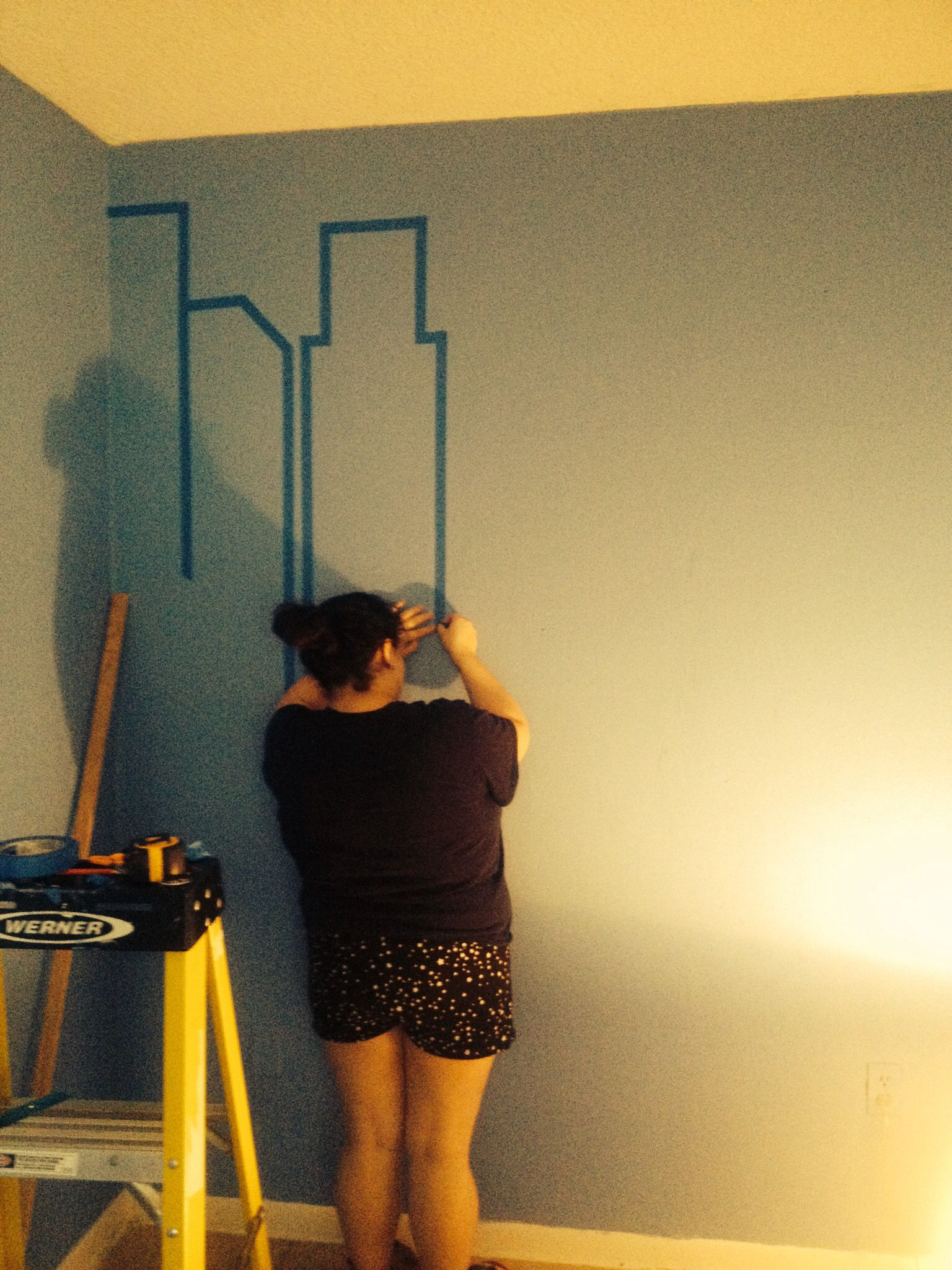 Mural comic skyline wall add art work and floating shelves for