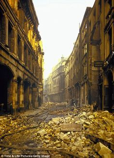 A deserted street in London after an air raid during the 2nd World War, 1940. Colour Photos from Time & Life Pictures.