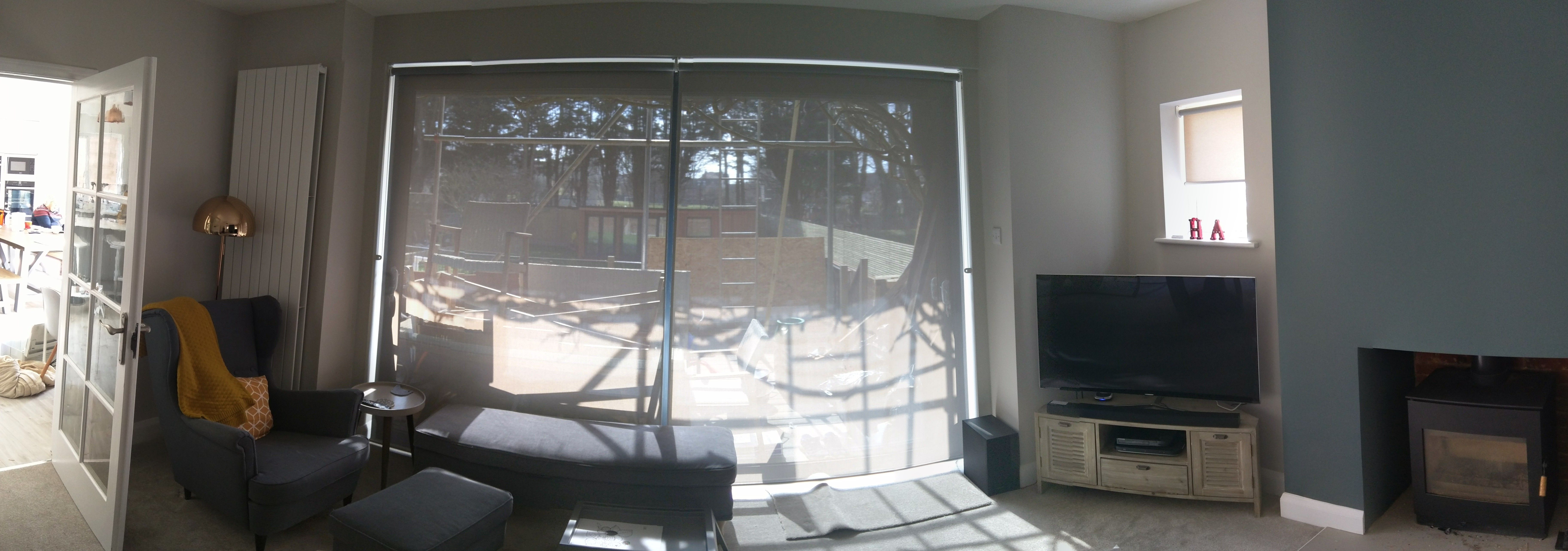 Sunscreen roller blinds we fitted to sliding doors in living room in