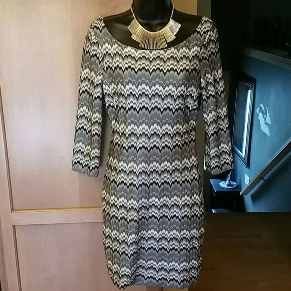 Beautiful dress!!! Beautiful design, 3/4 sleeves with an open back. Length from arm pit is 26 inches. As U Wish Dresses Midi