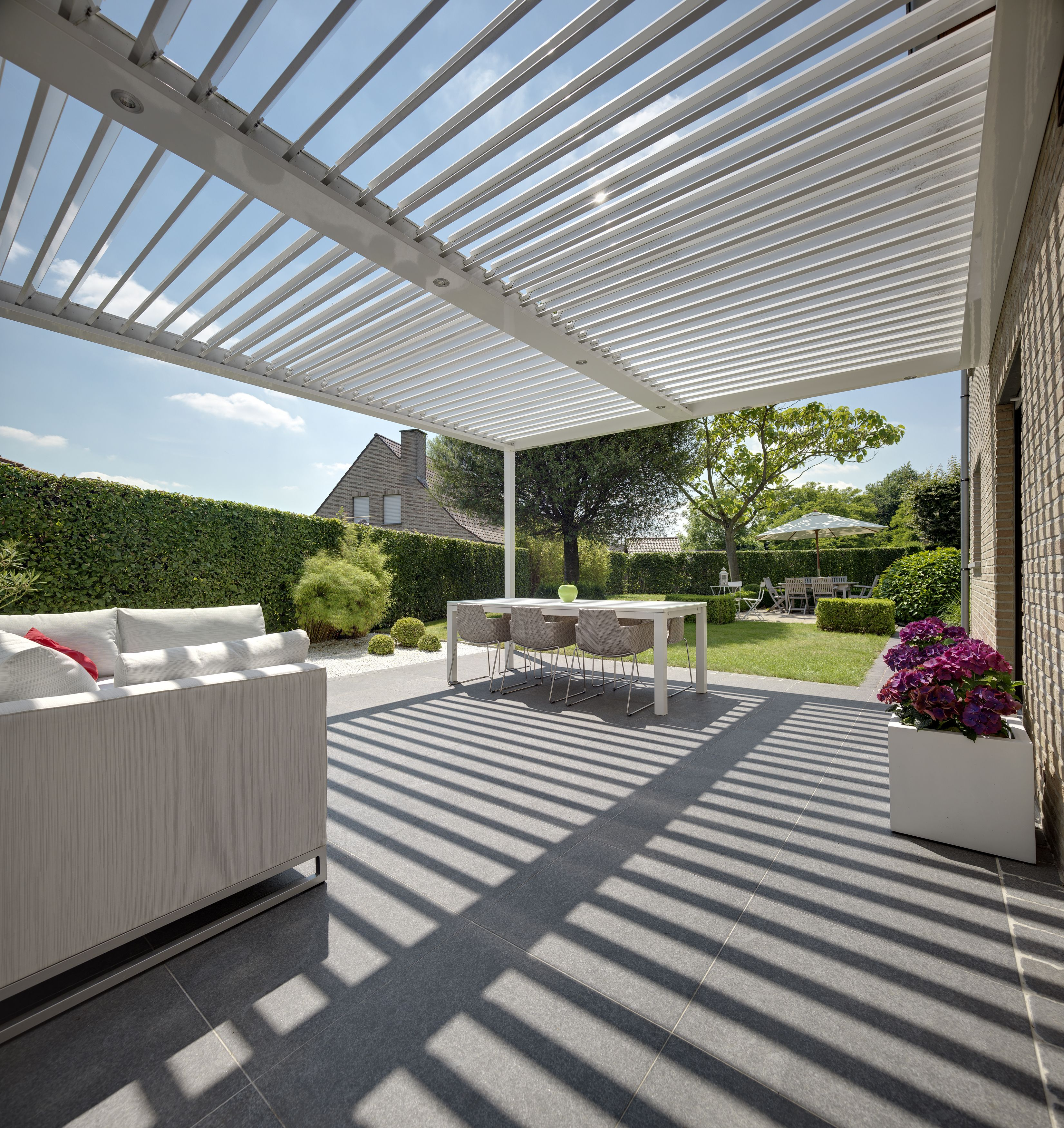 opulent design retractable roof. The Umbris patio roofing system is a bespoke  architectural design solution creating external living and