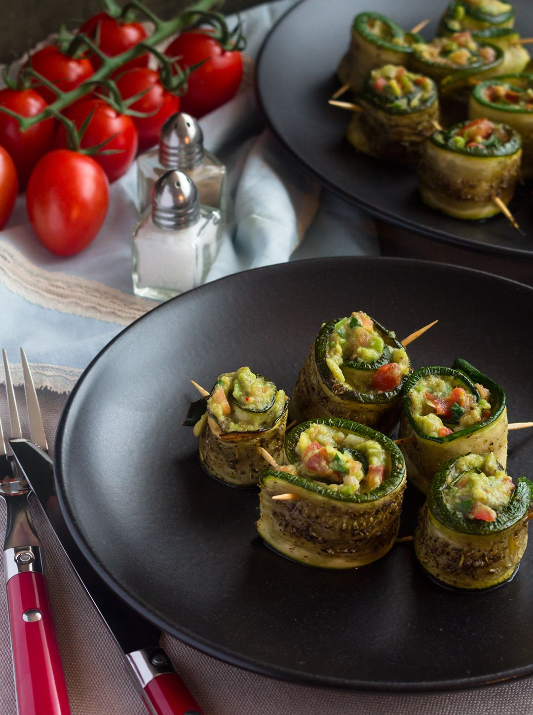 Roasted Zucchini Rolls with Guacamole Filling.