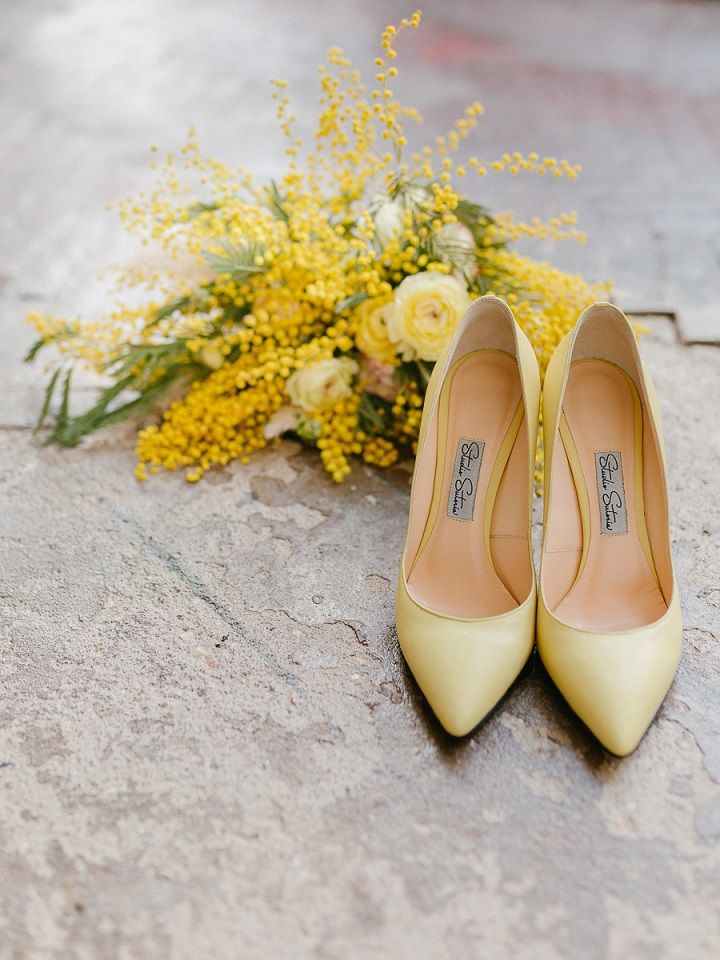 Yellow Mimosa Wedding Bouquet + Yellow bridal heels | Yellow Mimosa Flowers Inspired Wedding Shoot | fabmood.com #wedding #springwedding #yellowwedding #weddingbouquet #weddinginspiration