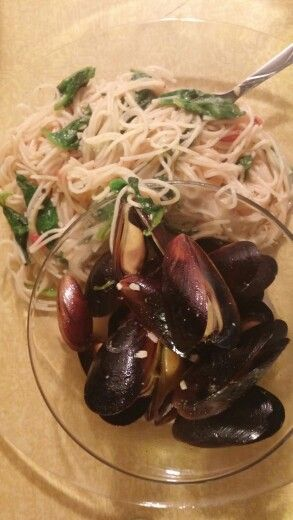 Mussels in a white wine butter garlic sauce and parmesean butter pasta with fresh spinach and tomatoes.