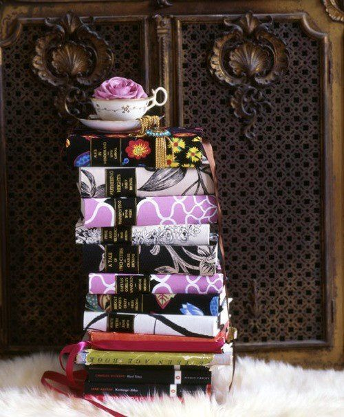 .Decorating with books. I really like this idea, can buy scrapbook paper in contrasting patterns and make diy bookcovers