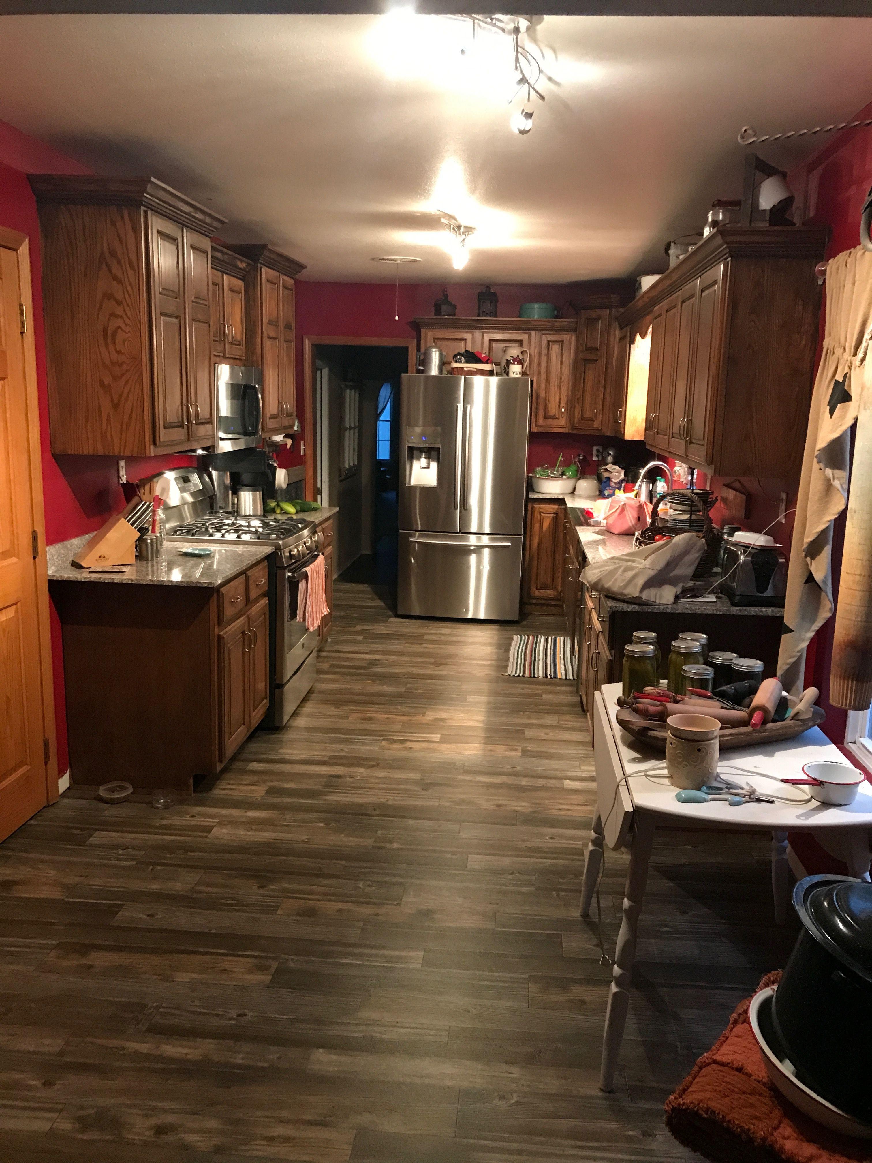 sheet vinyl rustic wood look flooring  updated kitchen