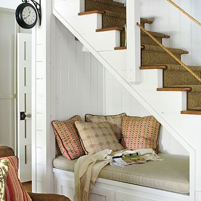 Reading Nook Under The Stairs - perfect for a house with teenagers. While waiting up till they get home, pull out a good book! Hey look! there's even a clock right there. : )