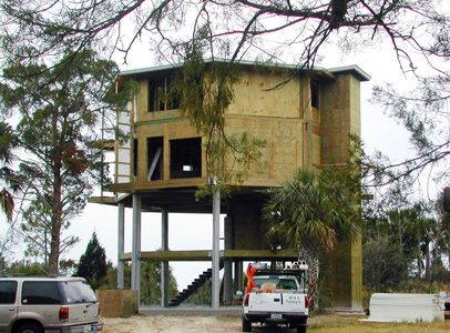 This elevated home on concrete pilings 20 ft above for Concrete pilings for house