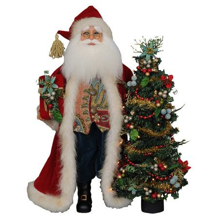 Add this classic Santa Claus statuette to the entryway console or living room mantel for a festive holiday display.  Product: St...