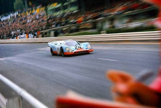 Jo Siffert heading past the pit area of Spa Francorchamps