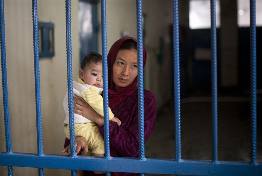 """Prisoner Nuria with her infant son. """"When I went to court for the divorce, instead of giving me a divorce, they charged me with running away,"""" Nuria said. The man she wanted to marry was also charged and is now serving time in Afghanistan's notorious Pul-e-Charkhi prison."""
